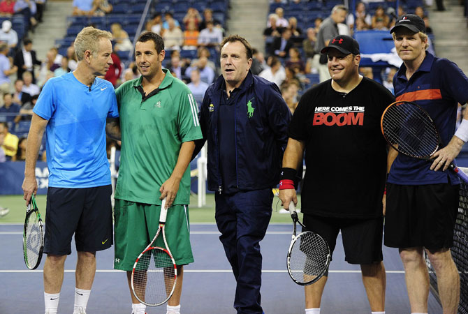 (Left to Right) John McEnroe, actor Adam sandler, actor Colin Quinn, Jim Courier and actor Kevin James pose during an exhibition match at the 2012 US.