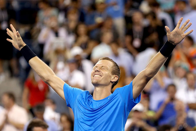 Tomas Berdych of the Czech Republic celebrates defeating Roger Federer of Switzerland after their men's singles quarterfinal match against on Day Ten of the 2012 US.