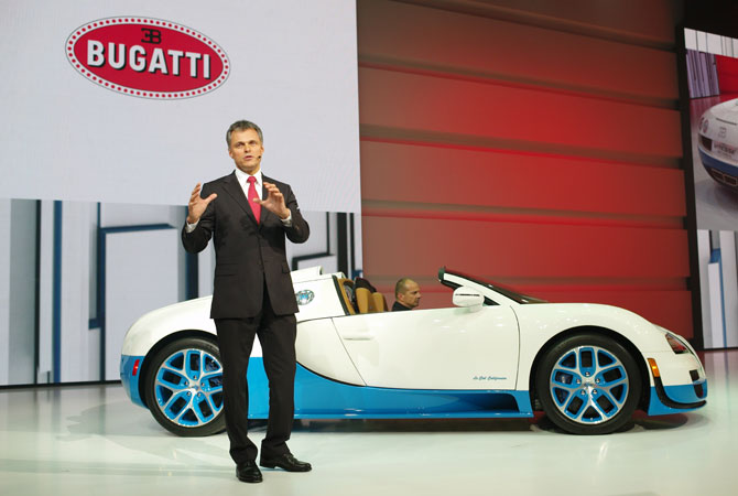 Bugatti CEO Wolfgang Schreiber speaks at the Volkswagen Group Night, in Paris, Wednesday Sept. 26, 2012.