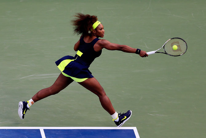 Serena Williams of the United States returns a shot during the women's singles final match against Victoria Azarenka of Belarus on Day Fourteen of the 2012 U.S. Open.