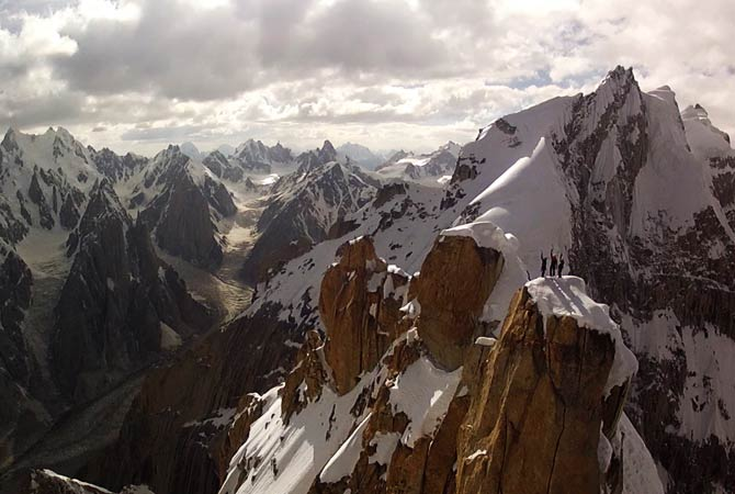 This photo is taken from a camera mounted to a remote-controlled helicopter showing Peter Ortner, Corey Rich and David Lama standing atop the Trango Summit. ? Photo by AP
