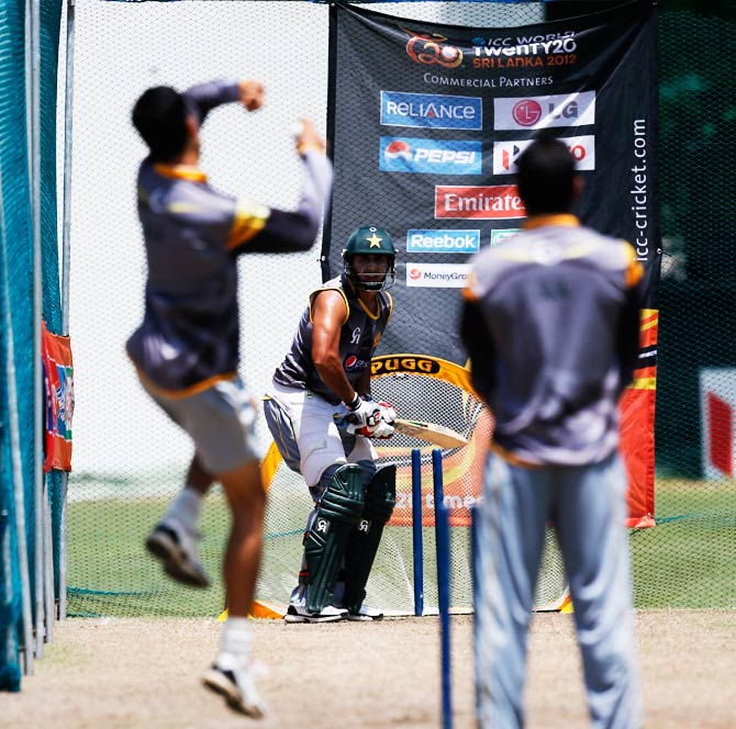 Pakistan's Nasir Jamshed, center, practices his batting. ? Photo by AP