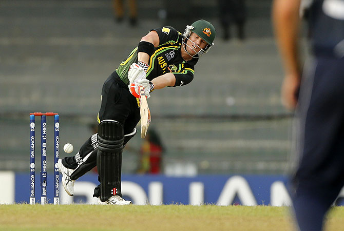 David Warner times one to the boundary. -Photo by AP
