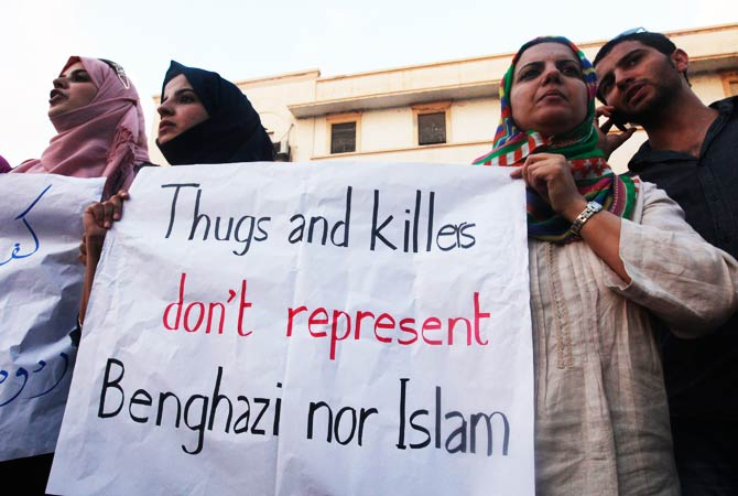 Demonstrators hold a placard during a rally to condemn the killers and voice support for the U.S. Ambassador Christopher Stevens and three embassy staff who were killed. ? Photo by Reuters