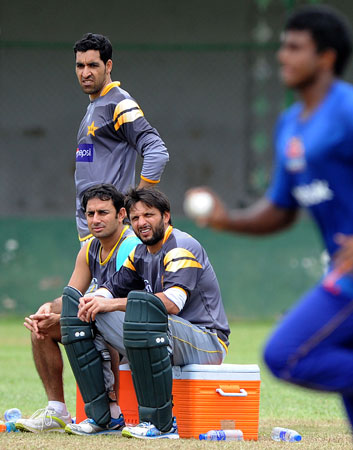 Pakistan cricketers Umar Gul (Left), Saeed Ajmal (2nd Left), and Shahid Afridi (2nd Right) watch other players  during an ICC Twenty20 Cricket World Cup practice session at the P. Sara Oval Cricket Stadium in Colombo on September 27, 2012. ? Photo by AFP