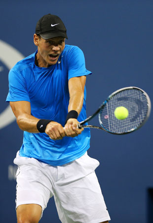 Tomas Berdych of Czech Republic returns a shot during his men's singles quarterfinal match against Roger Federer of Switzerland on Day Ten of the 2012 US.