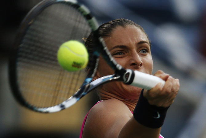 Sara Errani of Italy hits a return to Serena Williams of the US. -Photo by Reuters