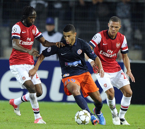 Montpellier's Moroccan midfielder Younes Belhanda vies with Arsenal's Ivorian forward Gervinho (Left) and Arsenal's British defender Kieran Gibbs during the UEFA Champions League. ? Photo by AFP