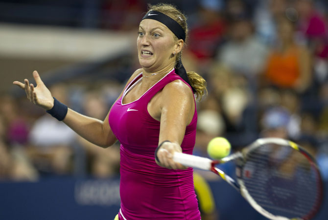 Petra Kvitova of the Czech Republic hits a return to Marion Bartoli of France during their women's singles fourth round match at the 2012 US Open tennis tournament. Bartoli won 1-6, 6-2, 6-0.