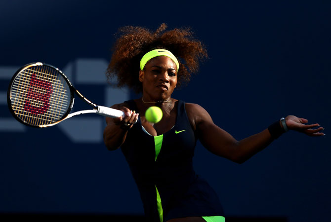 Serena Williams of the United States returns a shot during the women's singles final match against Victoria Azarenka of Belarus.