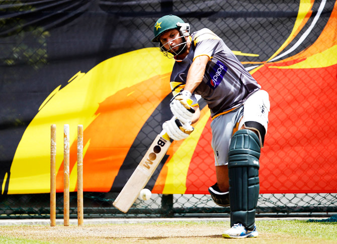 Shahid Afridi bats into the nets. ? Photo by AFP