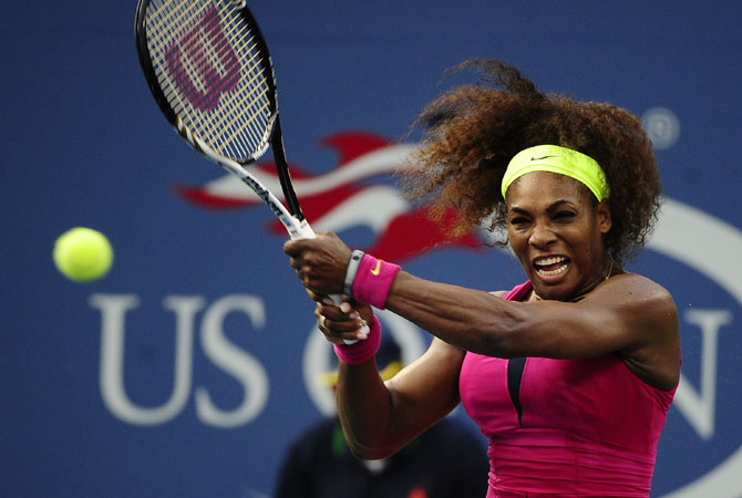 A thunderous return from Serena Williams of the US against Italys' Sara Errani. -Photo by AFP