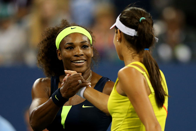 Serena Williams of the United States shakes hands with Ana Ivanovic of Serbia after their women's singles quarterfinal match on Day Ten of the 2012 US Open.