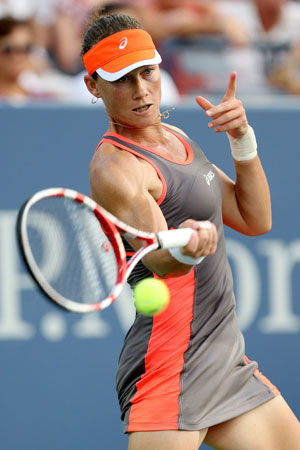 Samantha Stosur of Australia returns a shot during her women's singles fourth round match against Laura Robson of Great Britain on Day Seven of the 2012 US Open.