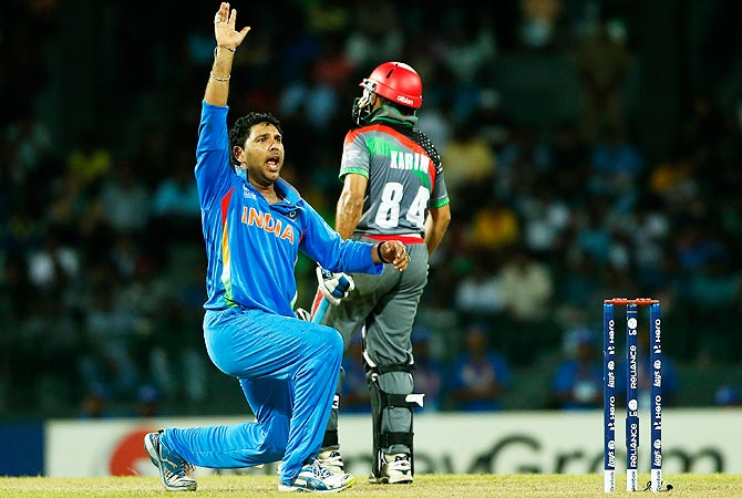 India's bowler Yuvraj Singh successfully appeals to dismiss Afghanistan's batsman Nawroz Mangal. -Photo by AP