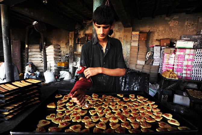 A baker makes traditional biscuits. ? Photo by AFP
