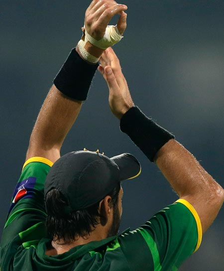 Shahid Afridi applauds the Pakistan supporters at the end of the third ODI against Australia. Afridi, seen here with a bandaged hand, injured his left hand during the match and will miss the first two matches of the T20 series against Australia. – Photo by AP