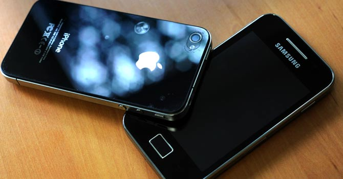 Apple's Iphone and Samsung's Galaxy smartphone – File photo by AFP