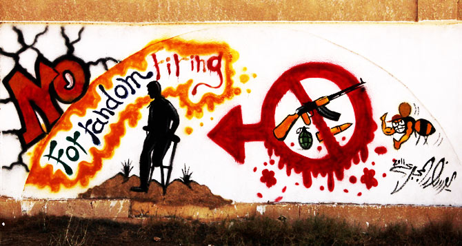 Graffiti on one of the city walls calls on people to stop random firing of weapons.