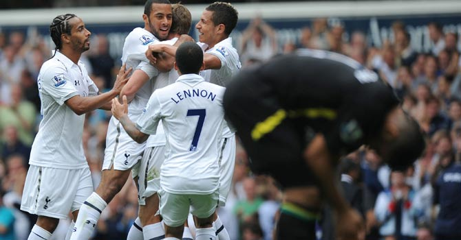 Tottenham Hotspur players celebrate with Belgian midfielder Mousa Dembele (2nd L) after his debut goal during the English Premier League football match between Tottenham Hotspur and Norwich City at White Hart Lane – Photo by AFP