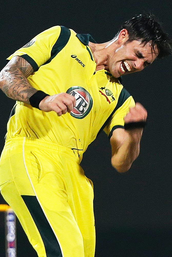 Mitchell Johnson celebrates taking the wicket of Pakistan's Nasir Jamshed. -Photo by AFP