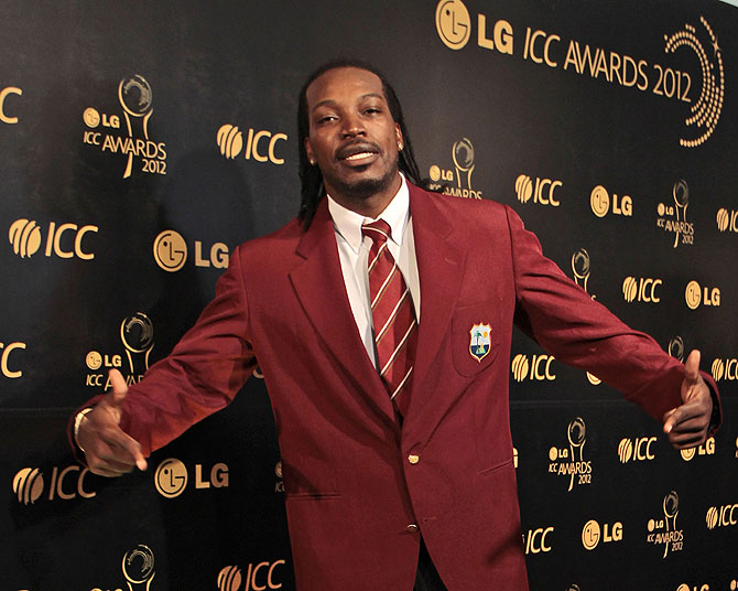 West Indies cricketer Chris Gayle poses as he arrives for the ICC Awards 2012 in Colombo, Sri Lanka. -Photo by AP