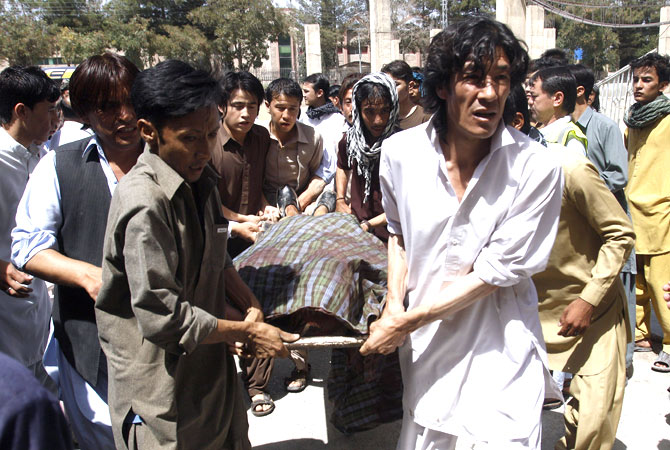 Pakistani Hazara Shia Muslims carry the body of a person killed by gunmen at a local hospital in Quetta, on Saturday, Sept. 1, 2012.