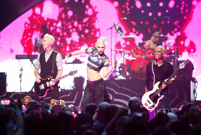 Gwen Stefani of the band No Doubt performs with guitarist Tom Dumont (L) and bassist Tony Kanal during the 2012 iHeartRadio Music Festival at the MGM Grand Garden Arena in Las Vegas, Nevada September 21, 2012.