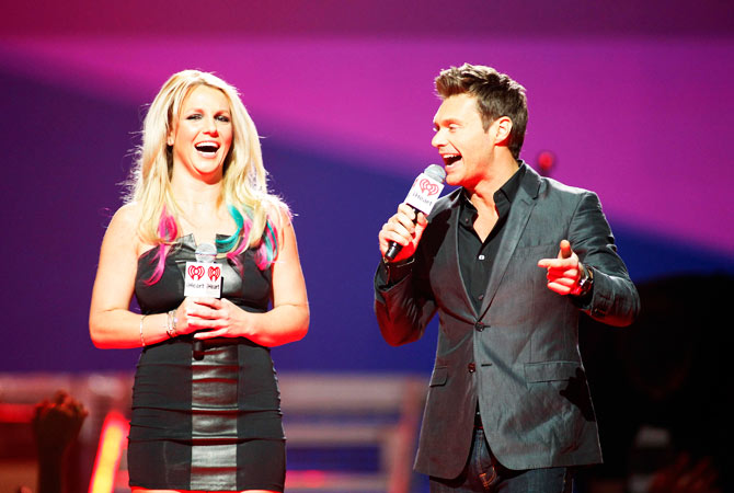 Britney Spears and host Ryan Seacrest introduces a musical group.