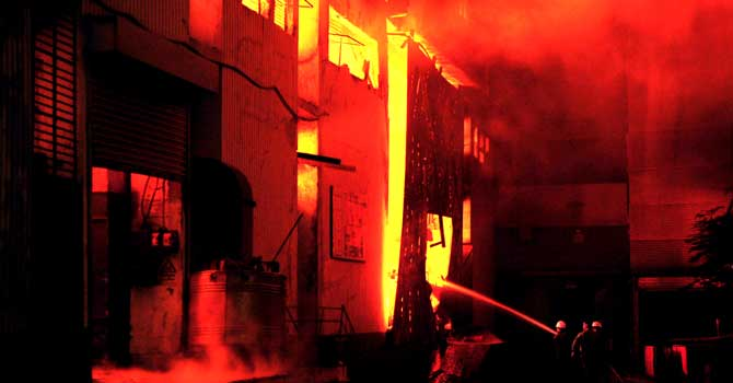 Fire-fighters try to control the blaze at Karachi's garment factory on September 11, 2012. - Photo by AFP