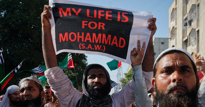Supporters of the religious party Ahle Sunnat wal Jamaat listen to the speeches of their leaders during a protest rally against an anti-Islam film made in the U.S. they say mocks the Prophet Mohammad, in Karachi September 30, 2012.