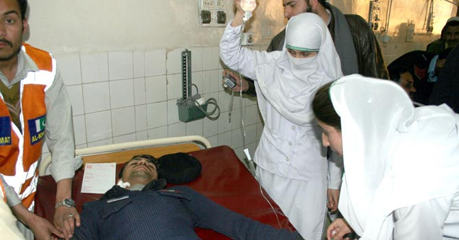 Staff at the Lady Reading Hospital in Peshawar work with victims of a terrorist attack. – Photo courtesy Media Cell, Lady Reading Hospital