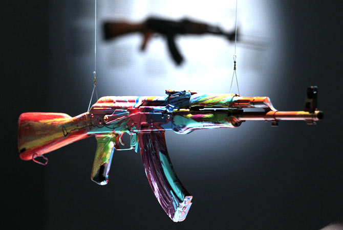 An interpretation of an AK-47 assault rifle ?Spin AK47 for Peace One Day? by British artist Damien Hirst is seen on display in an exhibition 'AKA Peace' at the Institute of Contemporary Arts in London, Wednesday, Sept. 26, 2012.