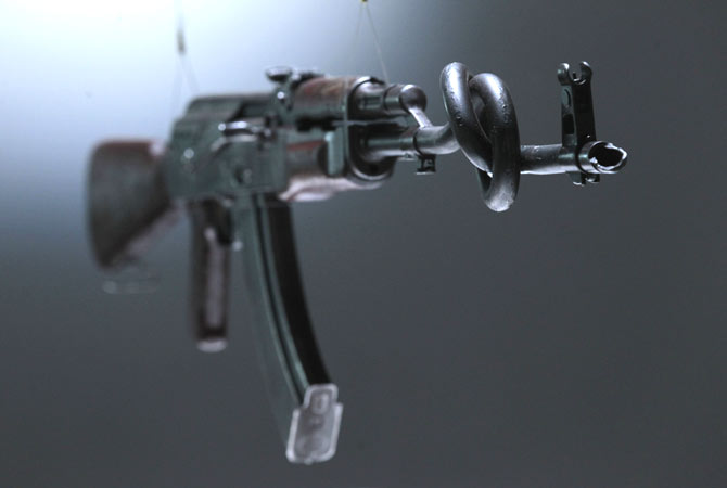 An interpretation of an AK-47 assault rifle by British artists Tim Noble and Sue Wenster is seen on display in an exhibition 'AKA Peace' at the Institute of Contemporary Arts in London, Wednesday, Sept. 26, 2012.