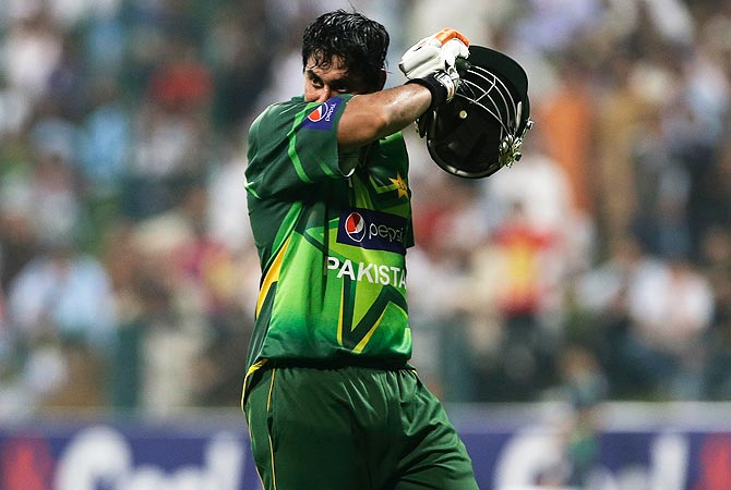 Nasir Jamshed walks off the field after being dismissed by Mitchell Johnson. Jamshed made 97 runs. -Photo by AP
