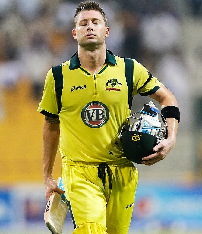 Michael Clarke walks off the field after being dismissed. -Photo by AP