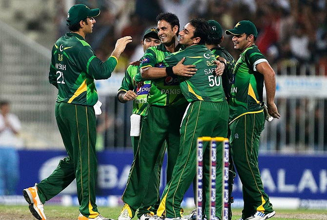 Pakistan's Abdur Rehman, second left, celebrates with his teammates after taking the wicket of Australia's Matthew Wade. -Photo by AP