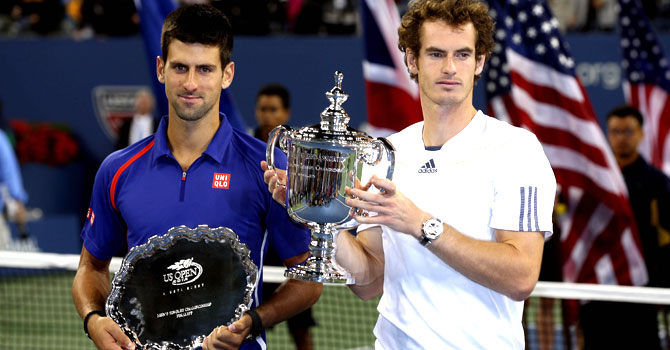 Andy Murray of Great Britain poses with the US Open championship trophy next to Novak Djokovic of Serbia after his victory in the men's singles final match on Day Fifteen of the 2012 US Open — Photo by AFP