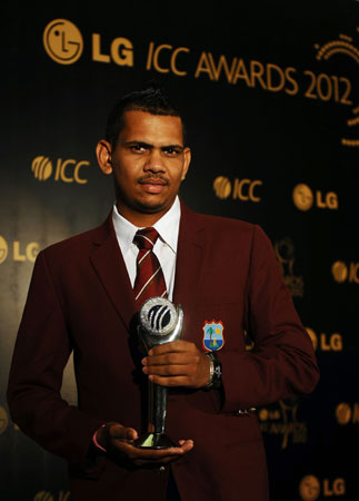 West Indies cricketer Sunil Narine poses with his award after being named the ICC ODI Cricketer of the Year. -Photo by AFP