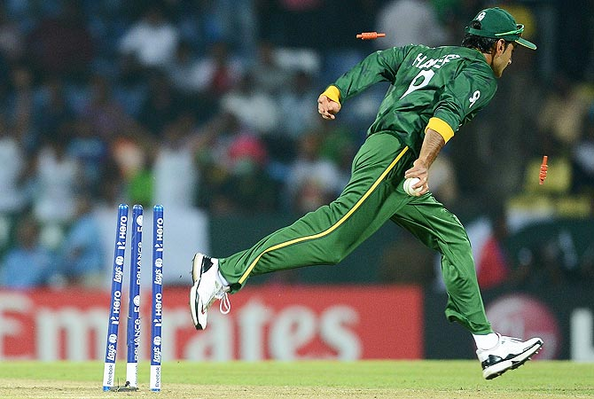 Bails go in the air as Pakistan's Mohammad Hafeez successfully runs out Bangladesh 's Tamim Iqbal. -Photo by AFP