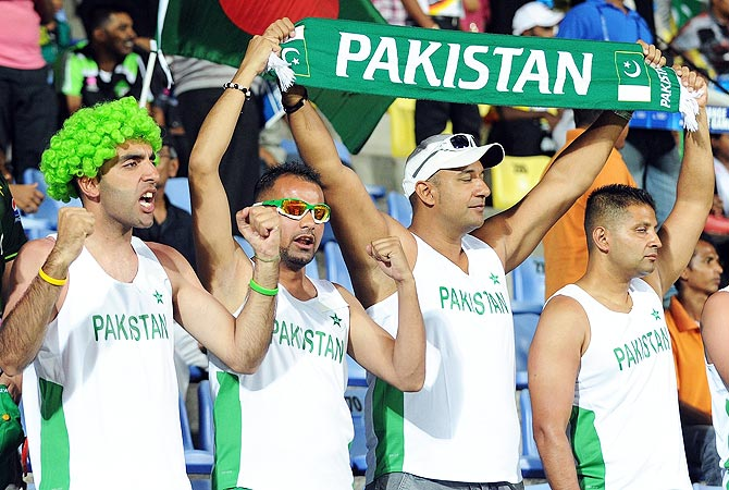 Pakistan cricket fans cheer during the match. -Photo by AFP
