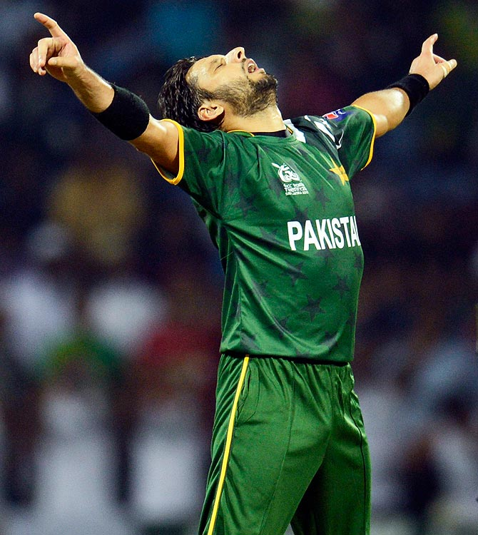 Pakistan's Shahid Afridi celebrates the dismissal of Bangladesh's Mahmudullah. -Photo by Reuters