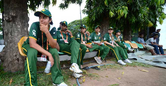 Pakistan's Marina Iqbal (L) and her teammates watch the ICC Women's World Twenty20 warm-up cricket match between England and South Africa at Moors Sports Club Ground in Colombo September 22, 2012. The women's tournament begins in Galle on Wednesday.  – Photo by Reuters