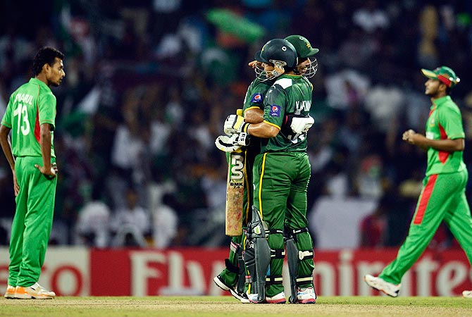 Pakistan's players embrace after beating Bangladesh. -Photo by Reuters
