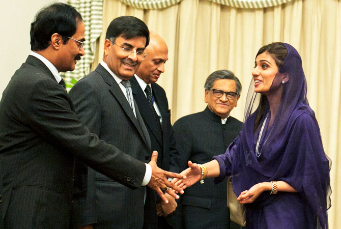 Pakistan's Foreign Minister Hina Rabbani Khar greets an Indian delegation led by Indian Foreign Minister S.M. Krishna (2nd R) at the prime minister's residence in Islamabad September 7, 2012.