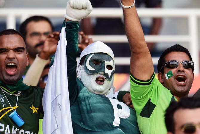 Pakistan fans cheer during the ICC Twenty20 Cricket World Cup match between Pakistan and New Zealand. -Photo by AFP