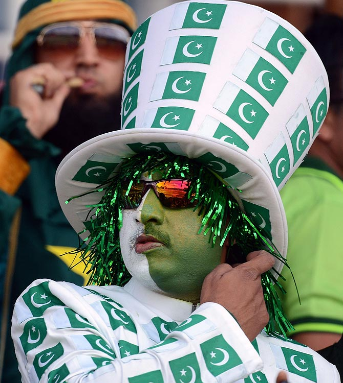 A Pakistan fan looks on during the match. -Photo by AFP