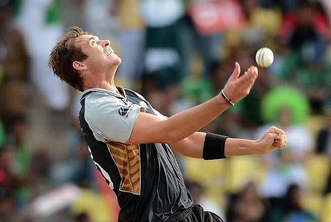 New Zealand bowler Tim Southee celebrates after taking a catch to dismiss Imran Nazir. -Photo by AFP