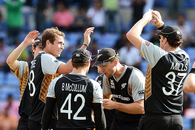 New Zealand celebrate the wicket of Imran Nazir. -Photo by AFP