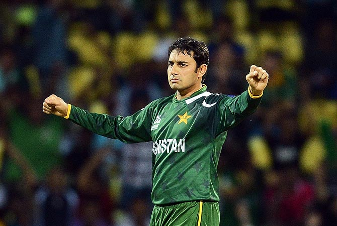 Saeed Ajmal celebrates taking the wicket of Daniel Vettori. -Photo by AFP